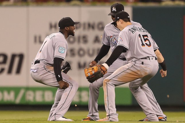 Miami Marlins (L to R) Cameron Maybin, Lewis Brinson and Brian Anderson celebrate a 7-4 win over the St. Louis Cardinals after the third out on June 5 at Busch Stadium in St. Louis. Photo by Bill Greenblatt/UPI