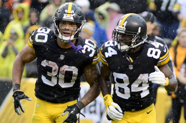 c51cd5685 Pittsburgh Steelers running back James Conner (30) celebrates his 22-yard  run for a touchdown with Pittsburgh Steelers wide receiver Antonio Brown (84)  in ...