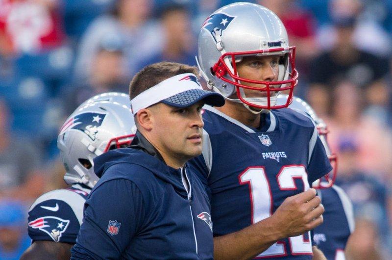 New England Patriots quarterback Tom Brady (R) gives a hug to offensive coordinator Josh McDaniels. File photo by Matthew Healey/UPI