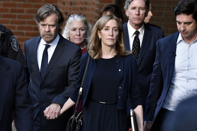 Felicity Huffman leaves her sentencing with her husband, William H. Macy (L), at the John Joseph Moakley United States Courthouse in Boston on Friday. Photo by Josh Reynolds/UPI