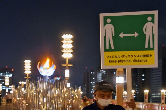 A sign encouraging physical distancing is seen at the Ariake Yume-no-Ohashi Bridge in Tokyo, Japan, on Thursday. Photo by Keizo Mori/UPI