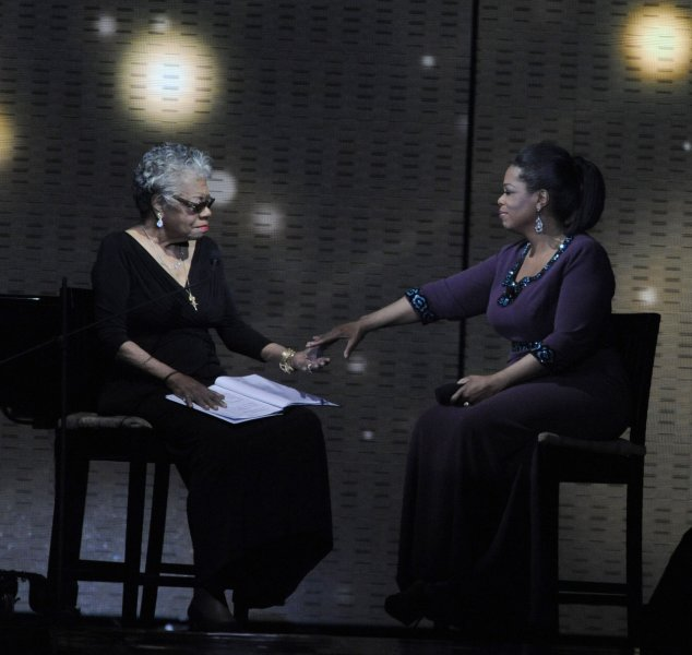 """Poet Maya Angalou (L) reads a new poem about Oprah Winfrey to Oprah during the taping of """"Surprise Oprah! A Farewell Spectacular"""" at the United Center in Chicago on May 17. 2011. The show, which featured several surprise celebrity guests, will air over two days, May 23 and 24. Oprah's final show will be a normal episode of The Oprah Winfrey Show taped at Harpo Studios and will air on May 25. UPI/David Banks"""