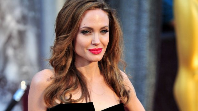 Angelina Jolie arrives on the red carpet at the 84th Academy Awards at the Hollywood and Highlands Center in the Hollywood section of Los Angeles on February 26, 2012. UPI/Kevin Dietsch