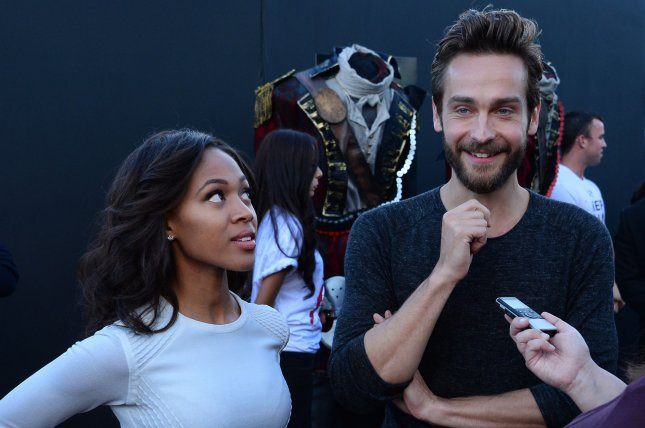 Cast members Nicole Beharie (L) and Tom Mison attend Fox's special screening of the television series Sleepy Hollow at the Hollywood Forever Cemetery in Los Angeles on June 2, 2014. Storyline: Ichabod Crane is resurrected and pulled two and a half centuries through time to unravel a mystery that dates all the way back to the founding fathers.