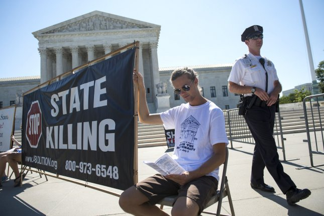 Death penalty opponents demonstrate outside the U.S. Supreme Court on June 29, 2015, in Washington, D.C. File Photo by Kevin Dietsch/UPI