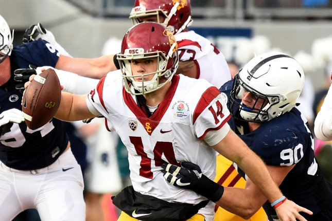 USC Trojans quarterback Sam Darnold #14 is caught from behind for no gain by the Penn State Nittany Lions defensive end Garrett Sickels #90 in the second quarter during the 2017 Rose Bowl in Pasadena, California on January 2, 2017. Photo by Juan Ocampo/UPI