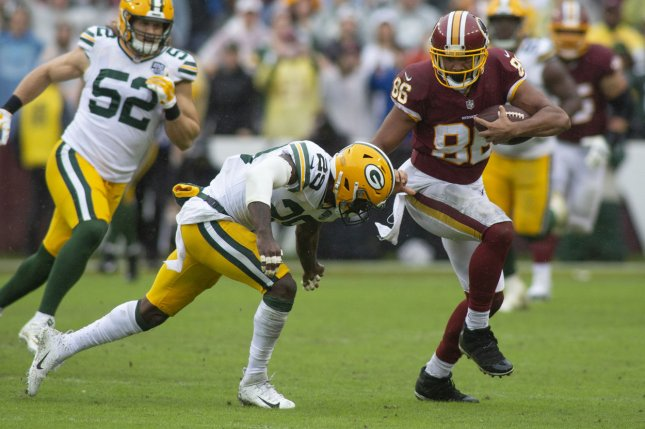 Washington Redskins tight end Jordan Reed (86) breaks a tackle by Green Bay Packers defensive back Kentrell Brice (29) during the NFL Week 3 game between the Washington Redskins and Green Bay Packers at FedEx Field in Landover, Maryland on September 23, 2018. Photo by Alex Edelman/UPI