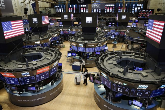 Workers sweep the floor of the New York Stock Exchange on Friday after the closing bell. Monday was the first day of all-electronic trading, the first time in history the trading floor is closed while the stock market is open. Photo by John Angelillo/UPI