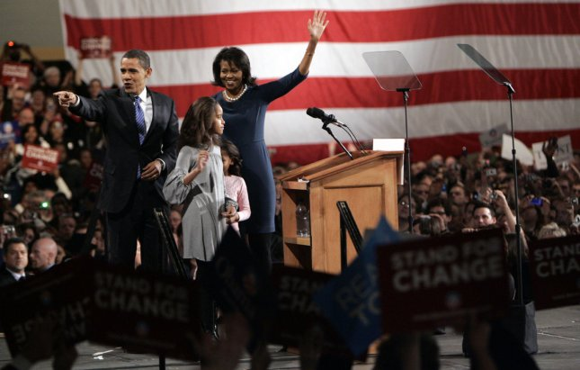 Democratic presidential hopeful Sen. Barack Obama (D-IL) and his wife Michelle wave to supporters at a victory rally in Des Moines, Iowa on January 3, 2008. Obama emerged with a clear win over rivals John Edwards and Hillary Clinton in the Democratic caucus. (UPI Photo/Mark Cowan)