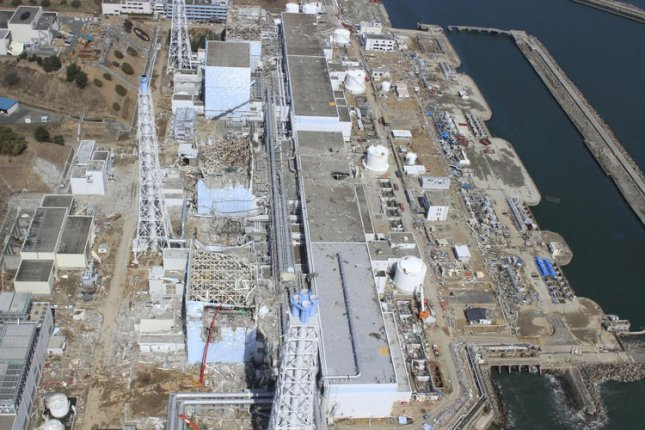 The crippled Fukushima Dai-ichi nuclear power plant is seen in Okumamachi, Fukushima prefecture, northern Japan in this March 20, 2011 aerial photo taken by a small unmanned drone and released by AIR PHOTO SERVICE. From top to bottom, Unit 1 through Unit 4. UPI/Air Photo Service Co. Ltd.