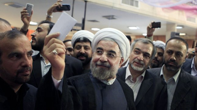 Iran's former top nuclear negotiator and presidential candidate Hassan Rouhani shows his ballot paper prior to voting in Iran's presidential elections at a polling station in Tehran, Iran on June 14, 2013. Iran's Supreme Leader Ayatollah Ali Khamenei urged all Iranians to vote and slammed suggestions by the United States that the election would be a sham. UPI/Maryam Rahmanian
