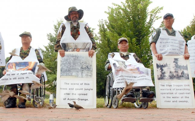 Vietnam War herbicide puts veterans at higher skin cancer risk. Members of the Korean Disabled Veteran's Association for Agent Orange hold a vigil to bring public attention to the suffering of troops who fought alongside U.S. soldiers in Vietnam near the White House in Washington. (UPI Photo/Roger L. Wollenberg)