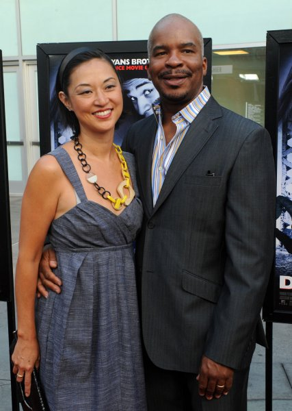 David Allen Grier, a cast member in the motion picture comedy Dance Flick attends the premiere of the film with his wife Christine Y. Kim at the Arclight Cinerama Dome in Los Angeles on May 20, 2009. (UPI Photo/Jim Ruymen)