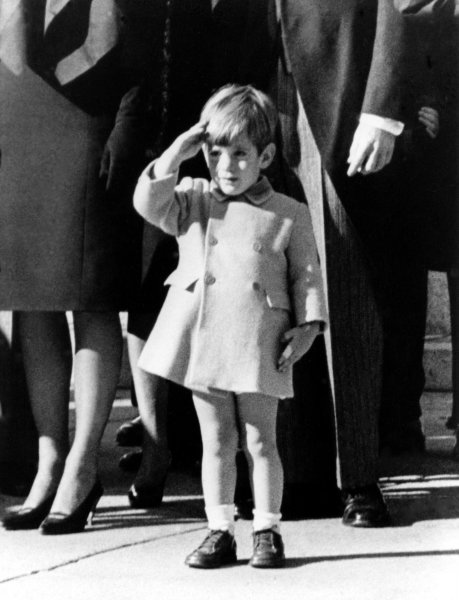 John F. Kennedy Jr. salutes as the casket of his father, President John F. Kennedy, is taken from St. Matthew's Cathedral to Arlington National Cemetery during funeral services November 25, 1963. (UPI/File)
