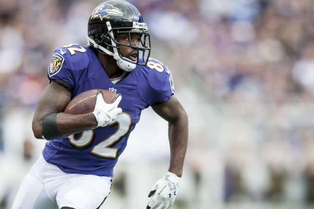 Former Baltimore Ravens' wide receiver Torrey Smith runs the ball during a 2013 game. Smith, now a player for the San Francisco 49ers, tweeted Aug. 19 that he prefers fictional presidential candidate Deez Nuts to Donald Trump. File Photo by Pete Marovich/UPI