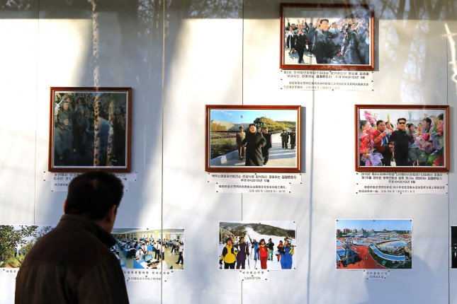 A Chinese man looks at photos of North Korea's leaders posted outside the North Korean embassy in Beijing. North Korea is unlikely to carry out new tests ahead of the U.S. presidential elections, according to a U.S. analyst. Photo by Stephen Shaver/UPI