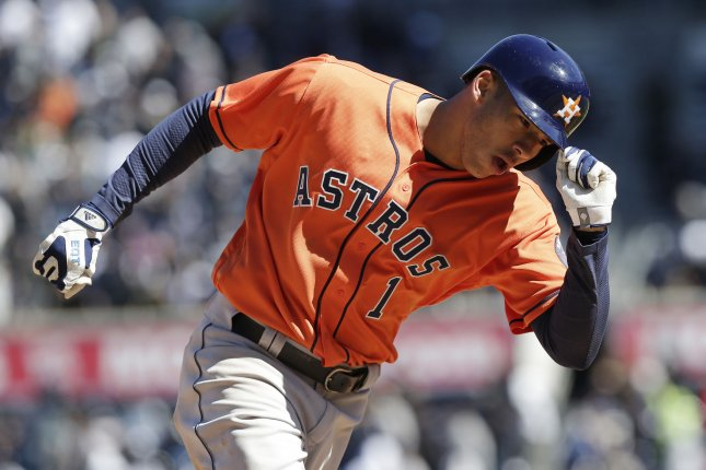 Houston Astros' Carlos Correa reacts and tips his hat while rounding third base. File photo by John Angelillo/UPI