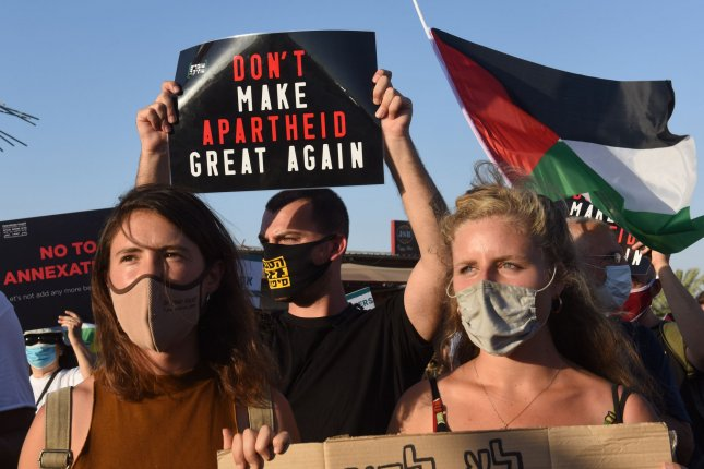 Palestinians and Israeli activists protest a plan by the Israeli government to annex parts of the West Bank, at the Almog Junction near Jericho in the West Bank on June 27, 2020. File Photo by Debbie Hill/UPI