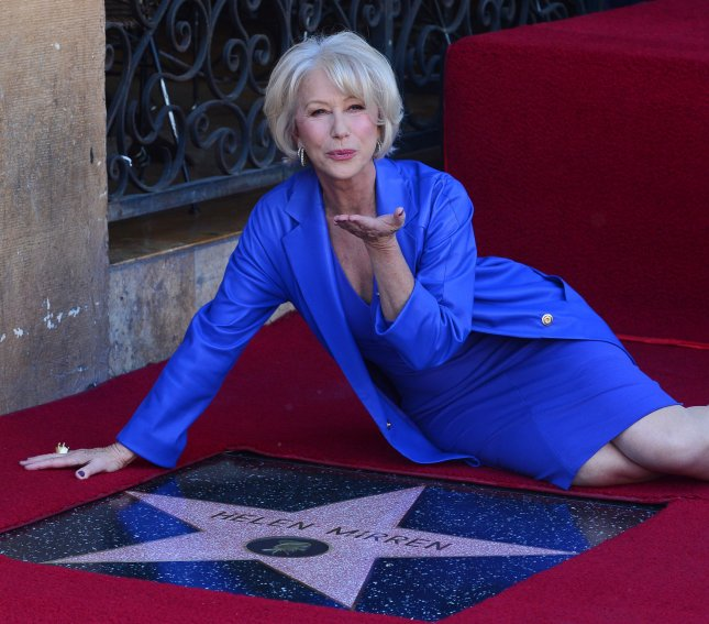 Academy award-winning actress Helen Mirren sits beside her star during an unveiling ceremony honoring her with the 2,488th star on the Hollywood Walk of Fame in Los Angeles on January 3, 2013. UPI/Jim Ruymen