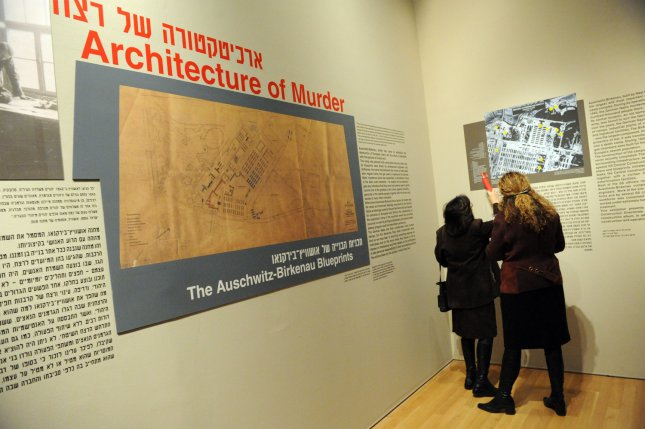 Members of the press view an exhibition at the Yad Vashem Holocaust Museum in Jerusalem entitled Architecture of Murder: The Auschwitz-Birkenau Blueprints before it's official opening, January 24, 2010. The exhibition contains original blueprints of the Nazi death camps Auschwitz-Birkenau, where approximately one million Jews were murdered during World War I. UPI/Debbie Hill