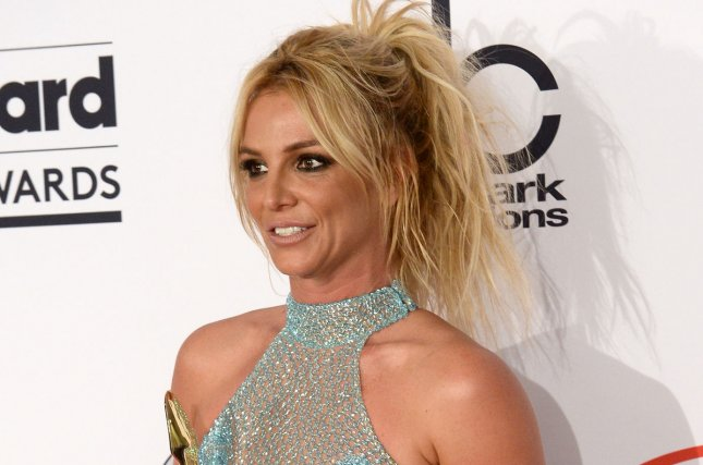 Singer Britney Spears appears backstage with the Millennium Award during the annual Billboard Music Awards in Las Vegas on May 22, 2016. File Photo by Jim Ruymen/UPI