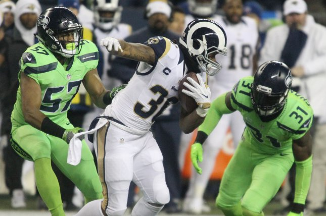 Los Angeles Rams running back Todd Gurley (30) is run down for a 7-yard loss by Seattle Seahawks outside linebacker Mike Morgan (57) and strong safety Kam Chancellor (31) at CenturyLink Field in Seattle, Washington on December 15, 2016. The Seahawks beat the Rams 24-3. Photo by Jim Bryant/UPI