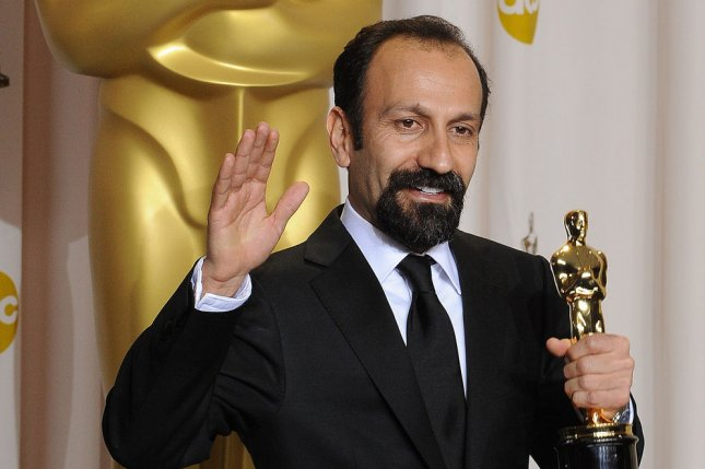 Iranian director Asghar Farhadi holds his Oscar for Best Foreign Language Film for A Separation while backstage at the 84th Academy Awards in 2012. Farhadi is again nominated this year, but may be barred from entering the United States to attend the ceremony under President Donald Trump's temporary ban on visas for citizens of seven predominantly Muslim countries, including Iran. File photo by Jim Ruymen/UPI