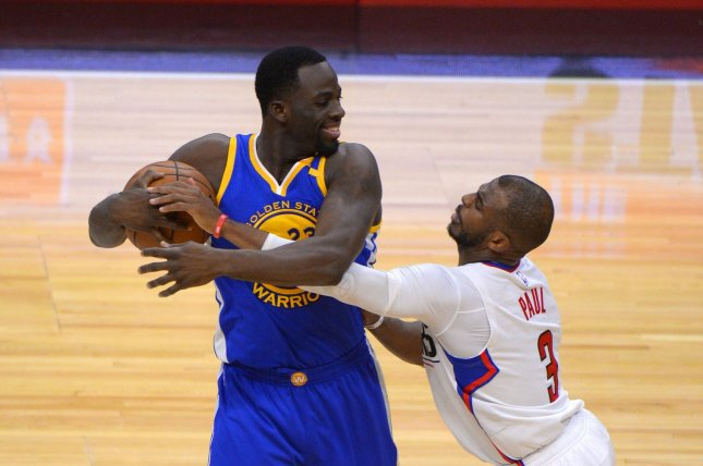 Warriors' Draymond Green keeps ball away from Clippers guard Chris Paul (3) at Staples Center in Los Angeles, December 7, 2016. Photo by Jon SooHoo/UPI