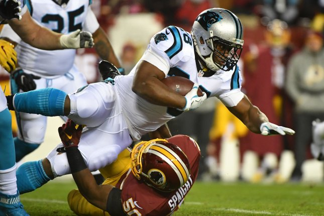 Carolina Panthers running back Jonathan Stewart (28) dives over Washington Redskins outside linebacker Martrell Spaight (50) in the first quarter at FedEx Field in Landover, Maryland on December 19, 2016. File photo by Kevin Dietsch/UPI