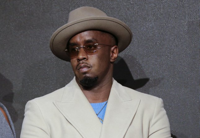 Sean 'Diddy' Combs listens on the stage at The Pirelli 2018 Calendar on November 10 in New York City. This week, Diddy was named music's top earner, according to Forbes' highest-paid musician list for 2017. Photo by John Angelillo/UPI