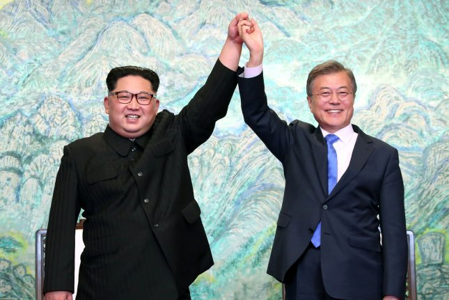 South Korean President Moon Jae-in (R) and North Korean leader Kim Jong Un announce the joint Panmunjom Declaration at the Peace House in the border village of Panmunjom in Paju, South Korea, on Friday. Photo by Inter-Korean Summit Press Corps/UPI