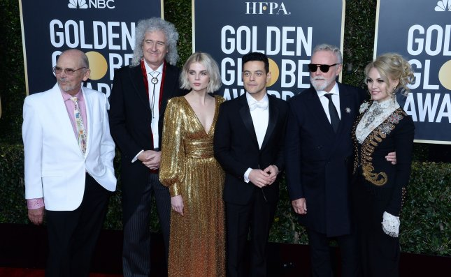 L-R John Deacon, Brian May, Lucy Boynton, Rami Malek, Roger Taylor, and Sarina Potgieter attend the 76th annual Golden Globe Awards on behalf of their film Bohemian Rhapsody in Beverly Hills Sunday. Photo by Jim Ruymen/UPI