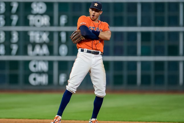Houston Astros shortstop Carlos Correa is hitting .295 with 11 home runs and 35 RBIs for Astros, but will be out of the team's lineup for four to six weeks after suffering a fractured rib. Photo by Trask Smith/UPI
