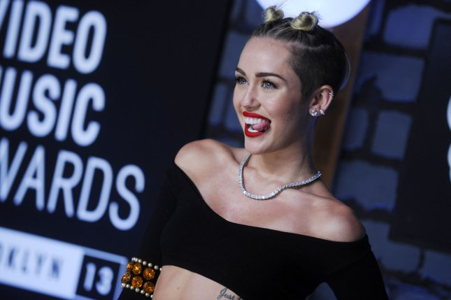 Miley Cyrus arrives on the red carpet at the 2013 MTV Video Music Awards at Barclays Center in New York City on August 25, 2013. This is the first time the awards show has been held in Brooklyn and Barclays Center which opened last September. UPI/Dennis Van Tine