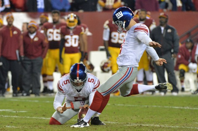 New York Giants kicker Josh Brown kicks a 39-yard field goal. Photo by Kevin Dietsch/UPI