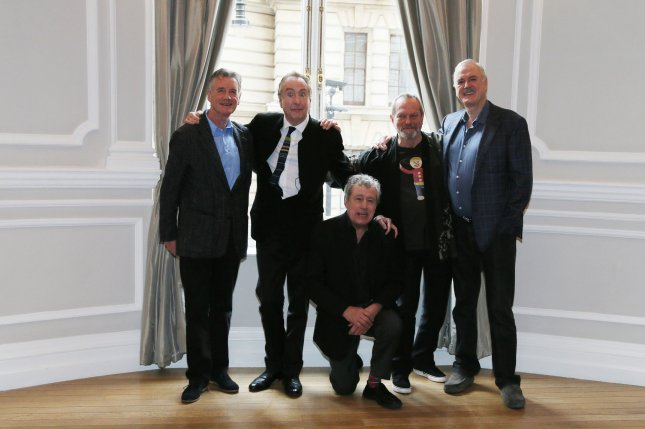 The Monty Python gang of (L-R) Michael Palin, Eric Idle,Terry Jones, Carol Cleveland, Terry Gilliam and John Cleese attend a photocall to publicize a a reunion show at the Corinthia Hotel in London on November 21, 2013. Jones has been diagnosed with a type of dementia. File photo by Hugo Philpott/UPI