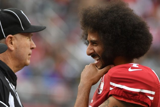 San Francisco 49ers QB Colin Kaepernick (R) jokes with an official in the third quarter against the New York Jets at Levi's Stadium in Santa Clara, California on December 11, 2016. The Jets came from behind to beat the 49ers 23-17 in overtime. Photo by Terry Schmitt/UPI
