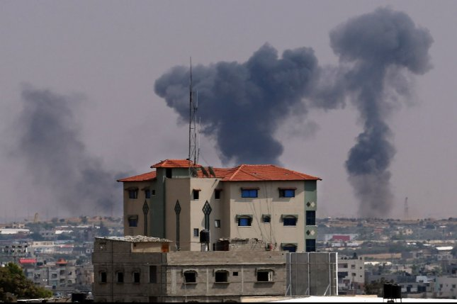 Smoke billows in the air Tuesday after an Israeli airstrike on the Palestinian enclave of Rafah in the southern Gaza Strip. The Israeli military launched a series of strikes on Palestinian positions in Gaza after a barrage of rocket fire from the Strip. Photo by Ismael Mohamad/UPI