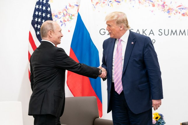 U.S. President Donald Trump greets Russian President Vladimir Putin at the G20 summit in Osaka, Japan, on June 28, 2019. Putin agreed to send medical supplies and equipment to the United States Wednesday to aid in fighting the coronavirus emergency. File Photo by Shealah Craighead/the White House/UPI