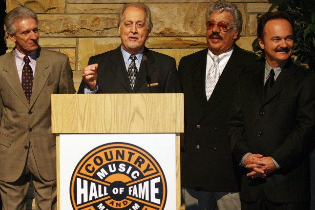 From left to right, members of the country music quartet The Statler Brothers -- Phil Balsley, Don Reid, Harold Reid and Jimmy Fortune -- address a crowd after being introduced as a 2008 Country Music Hall of Fame Inductee in Nashville, in 2008. Harold Reid died Friday. He was 80. File Photo by Frederick Breedon IV/UPI