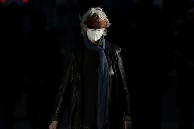 Pedestrians wear protective face masks as they walk on the sidewalk near Lincoln Center in New York City, which remains closed due to the COVID-19 pandemic, on May 13. Photo by John Angelillo/UPI