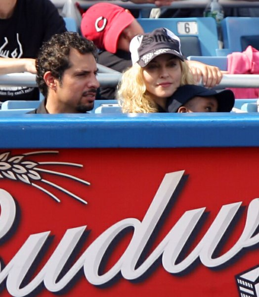 Madonna sits with son David Banda on her lap at the Cincinnati Reds New York Yankees game at Yankee Stadium in New York City on June 22, 2008. The Yankees defeated the Reds 4-1. (UPI Photo/John Angelillo)