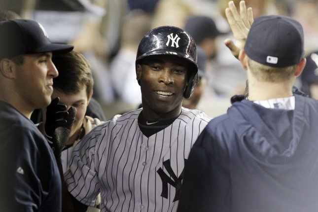 New York Yankees Alfonso Soriano reacts in the dug out after hitting a solo home run in the 2nd inning against the San Francisco Giants at Yankee Stadium in New York City on September 20, 2013. UPI/John Angelillo