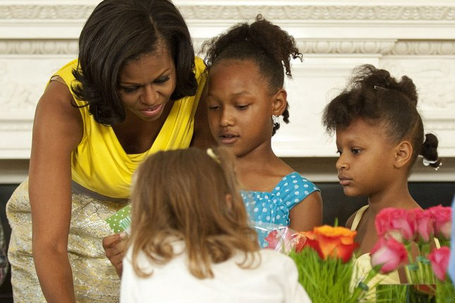 First lady Michelle Obama works on craft projects with children from military families during a Mother's Day event at the White House in May 2012. UPI/Kevin Dietsch