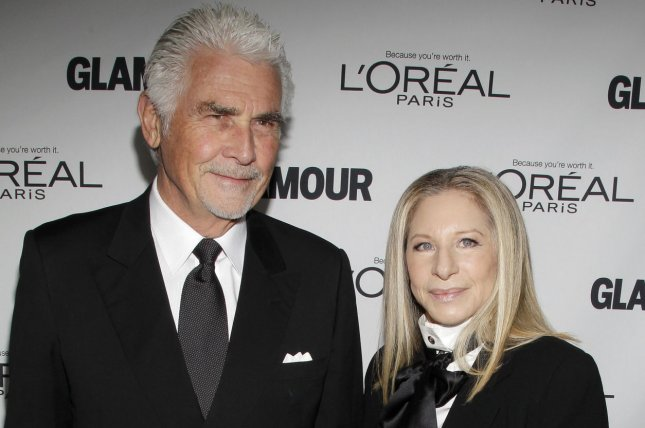 Barbra Streisand (R) and husband James Brolin at the Glamour Women of the Year Awards on Nov. 11, 2013. The couple hosted John Travolta, Lady Gaga and other famous friends over the weekend. File photo by John Angelillo/UPI