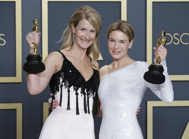 Laura Dern (L) and Renee Zellweger with the Oscars they won in February. Hollywood has been given the green light to resume TV and film production in California next week. File Photo by John Angelillo/UPI