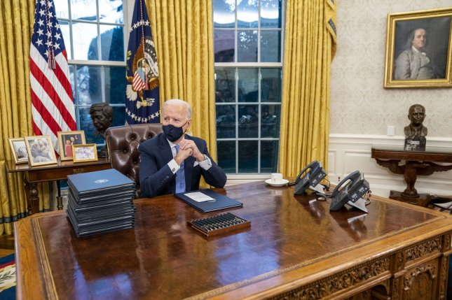 Behind President Joe Biden is a bust of Mexican-American civil rights activist Cesar Chavez, one of the many aesthetic changes made to the Oval Office by the new administration. Pool photo by Doug Mills/UPI