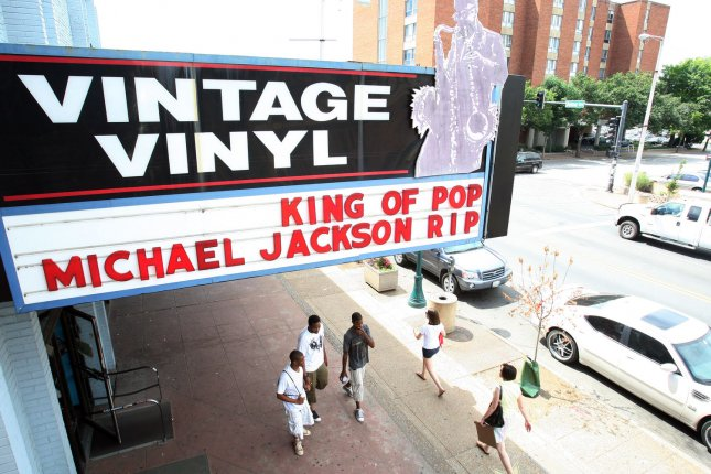 Customers leave the Vintage Vinyl music store where they have honored pop singer Michael Jackson on their sign in University City, Missouri on June 26, 2009. Jackson died of an apparent heart attack on June 25, 2009 in Los Angeles. (UPI Photo/Bill Greenblatt)