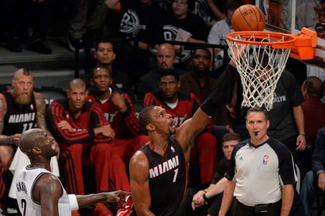 Miami Heat center Chris Bosh (1) lays up against Brooklyn Nets center Kevin Garnett (2) in the second quarter in Game 3 of the Eastern Conference Semifinals at Barclays Center in New York City on May 10, 2014. UPI/Rich Kane