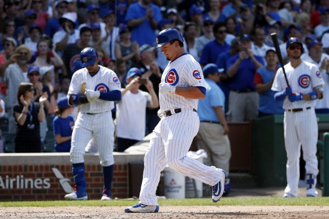 Chicago Cubs OF Kyle Schwarber crosses home plate after hitting a solo home run against the Colorado Rockies in the sixth inning on June 11 at Wrigley Field in Chicago, Ill. Photo by Kamil Krzaczynski/UPI